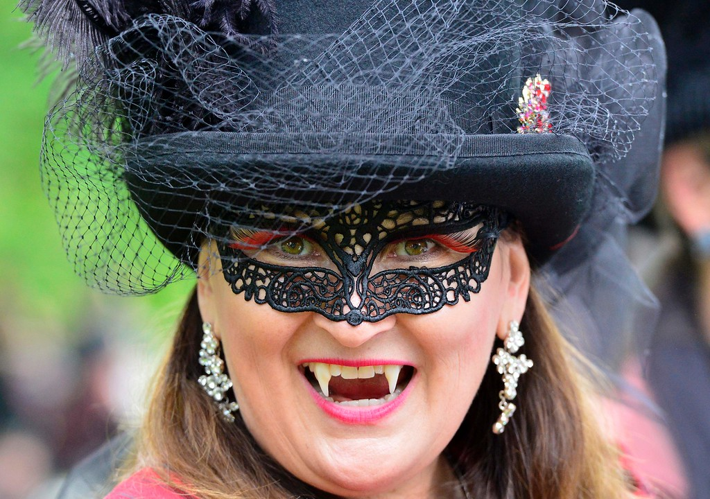 """. A dressed up woman poses at a so-called \""""Victorian Picnic\"""" during the Wave-Gotik-Treffen (WGT) festival in Leipzig, eastern Germany, on May 13, 2016.   / AFP PHOTO / TOBIAS SCHWARZ/AFP/Getty Images"""