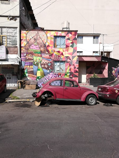 Street art and old red VW beetle