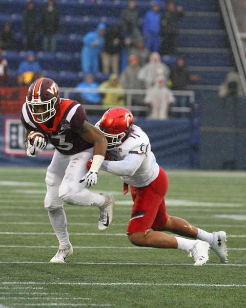 Cincinnati linebacker #11 Bryan Wright tackles Virginia Tech runningback #13 Jalen Holston