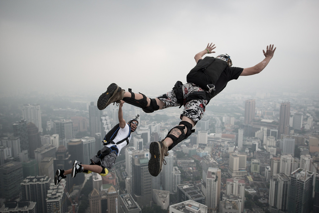 . Base jumper David Laffargue (R) and Rodolphe Roger Coianiz (L) from France leap from the 300-meters Open Deck of the Malaysia\'s landmark Kuala Lumpur Tower during the International Tower Jump in Kuala Lumpur on September 27, 2013. AFP PHOTO / MOHD RASFAN/AFP/Getty Images