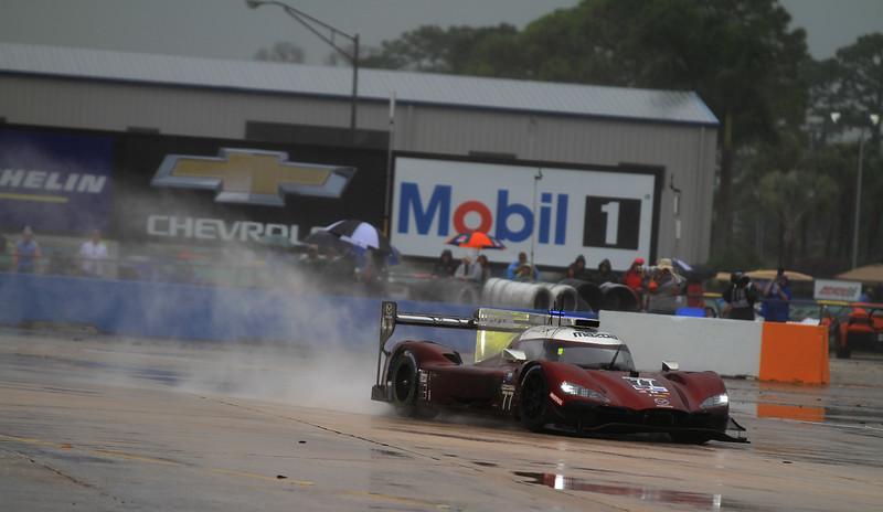Sebring 19_3243-#77-Mazda-spray.jpg