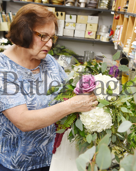Harold Aughton/Butler Eagle: Karen Stewart assembles a boquet of flowers for an upcoming wedding. Stewart has been working for Butler Florist for the past 56 years.