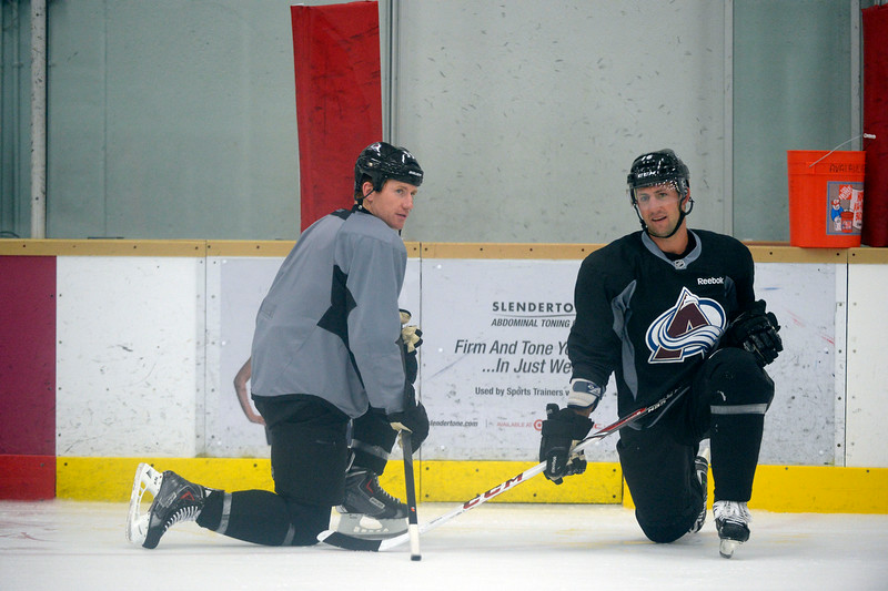 . Colorado Avalanche LW Cody McLeod (55) talks with Colorado Avalanche D Cory Sarich (16) (R) during practice September 9, 2013 at Family Sports. (Photo By John Leyba/The Denver Post)