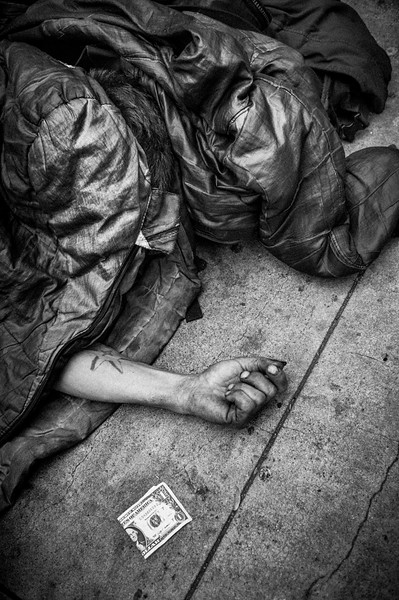 SLEEPING_HOMELESS_REACHING_OUT_FOR_DOLLAR_BILL_SAN_FRANCISCO.jpg