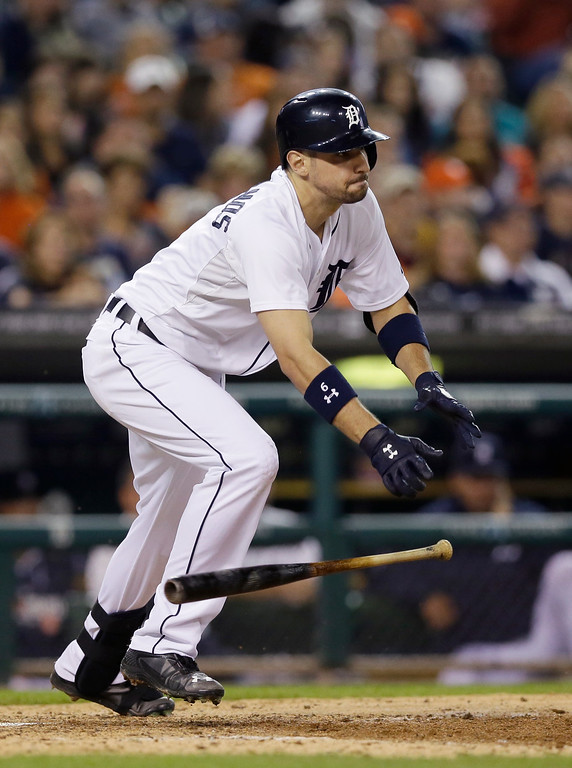 . Detroit Tigers\' Nick Castellanos grounds out to Minnesota Twins starting pitcher Ricky Nolasco but scores Torii Hunter during the sixth inning of a baseball game in Detroit, Saturday, Sept. 27, 2014. (AP Photo/Carlos Osorio)