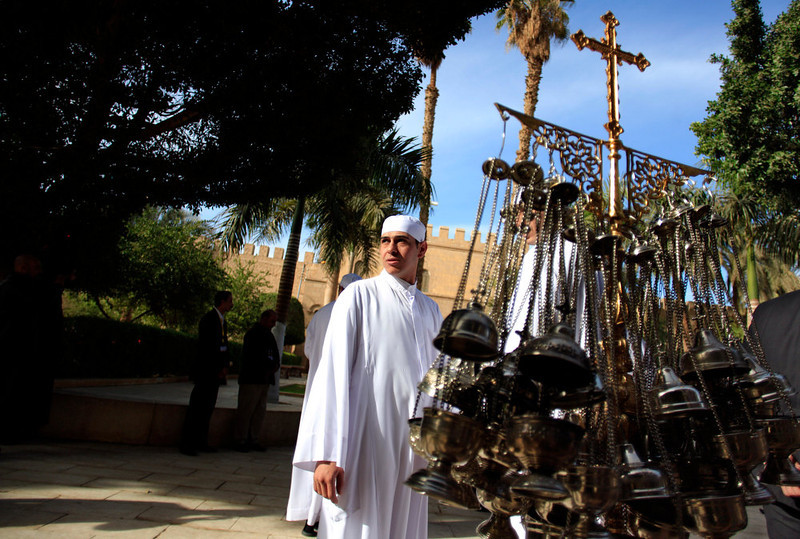. A clergyman stands next to censers during the preparations for the visit of Egypt\'s Coptic Christian pope, Tawadros II, at  the historic al-Muharraq Monastery, a centuries-old site some 180 miles (300 kilometers) south of Cairo in the province of Assiut, Egypt, Tuesday, Feb. 5, 2013. Egypt\'s Coptic Christian pope sharply criticized the country\'s Islamist leadership in an interview with The Associated Press on Tuesday, saying the new constitution is discriminatory and Christians should not be treated as a minority. (AP Photo/Khalil Hamra)