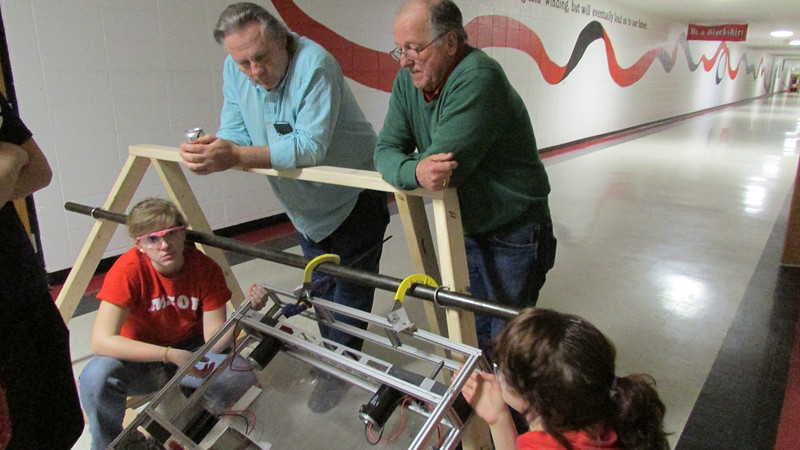 Mr. Skurulsky and Mr. Taylor  think while observing the prototype.