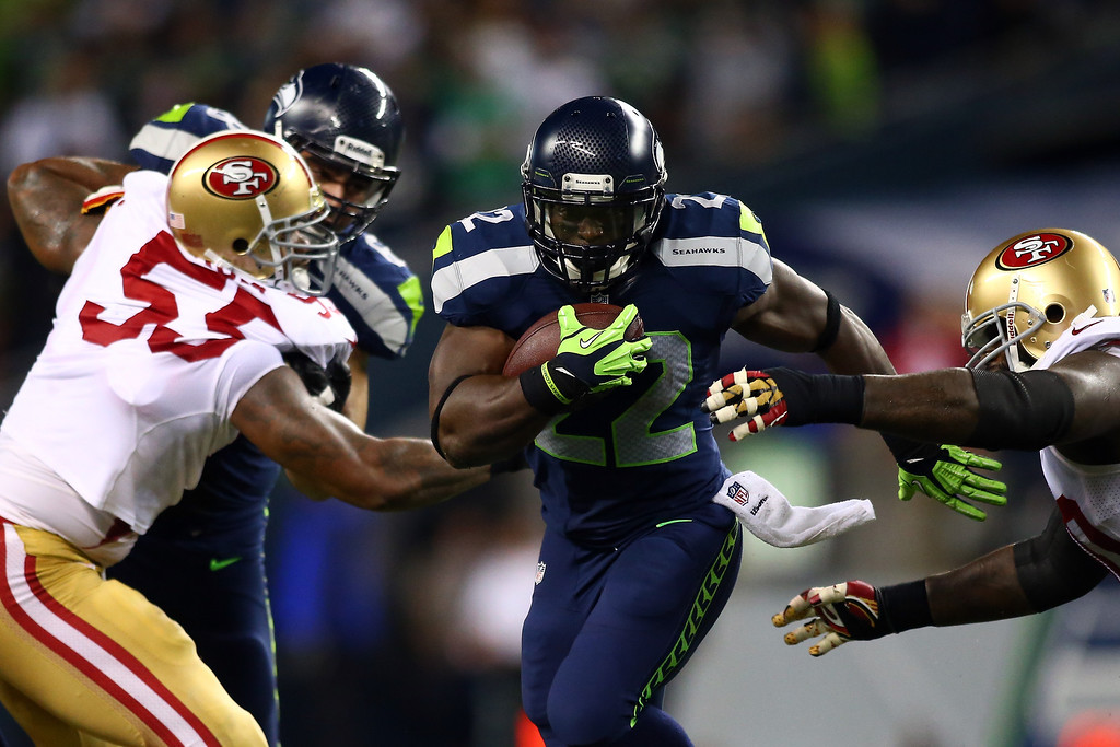 . Robert Turbin #22 of the Seattle Seahawks runs the ball against Ahmad Brooks #55 of the San Francisco 49ers during their game at Qwest Field on September 15, 2013 in Seattle, Washington.  (Photo by Jonathan Ferrey/Getty Images)