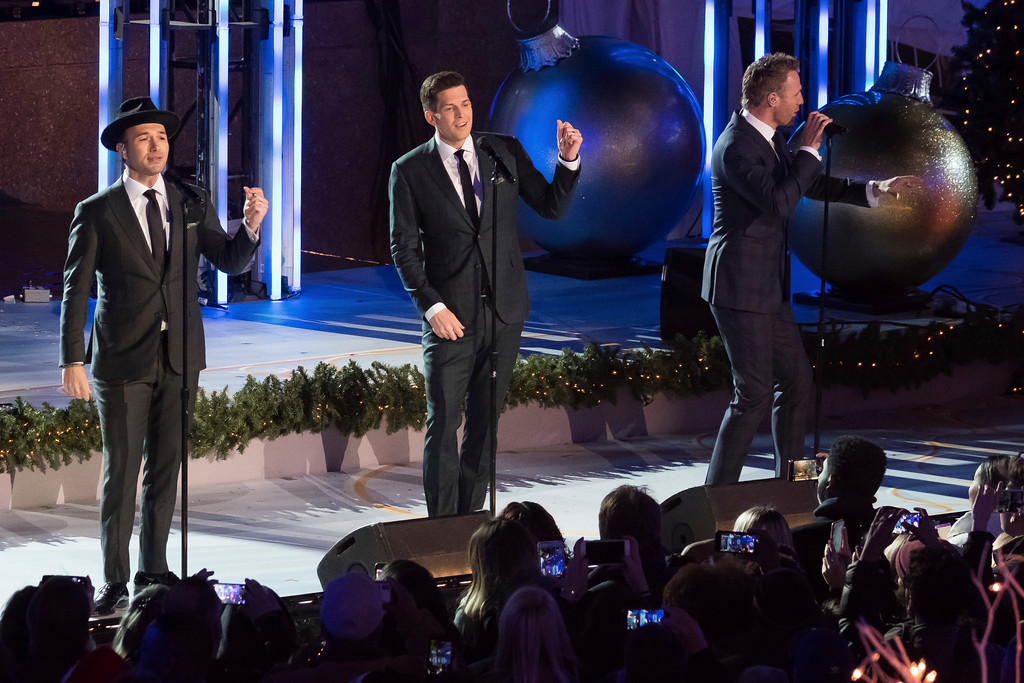 . Victor Micallef, left, Clifton Murray and Fraser Walters from The Tenors perform during the 85th annual Rockefeller Center Christmas Tree lighting ceremony on Wednesday, Nov. 29, 2017, in New York. (Photo by Charles Sykes/Invision/AP)