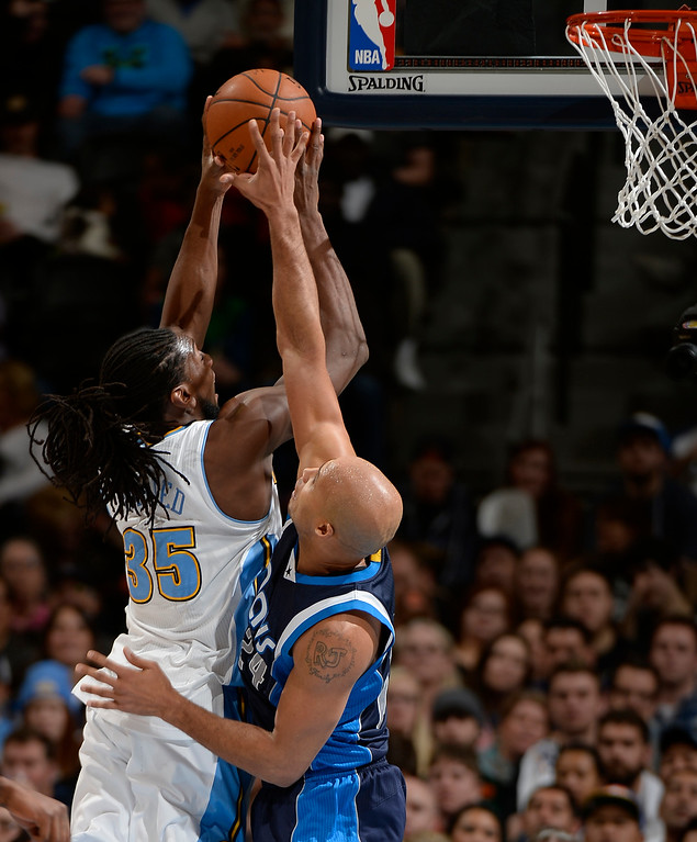 . DENVER, CO - JANUARY 14: Denver Nuggets forward Kenneth Faried (35) gets fouled by Dallas Mavericks forward Richard Jefferson (24) as he goes up for a shot during the fourth quarter January 14, 2015 at Pepsi Center. (Photo By John Leyba/The Denver Post)