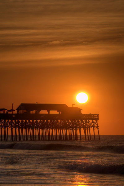 The sunrise at the fishing pier in Garden City Beach, SC on Tuesday, June 21, 2016. Copyright 2016 Jason Barnette