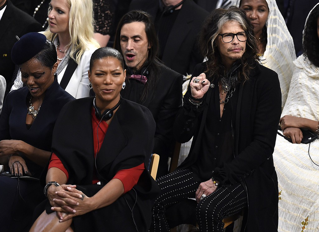 . US actress and singer Queen Latifah (C), singer of US band Aerosmith Steven Tyler (R) attend the Nobel Peace Prize awarding ceremony at the City Hall in Oslo on December 10, 2014. The 17-year-old Pakistani girls\' education activist Malala Yousafzai known as Malala shares the 2014 peace prize with the Indian campaigner Kailash Satyarthi, 60, who has fought for 35 years to free thousands of children from virtual slave labour.   AFP PHOTO / ODD ANDERSENODD ANDERSEN/AFP/Getty Images