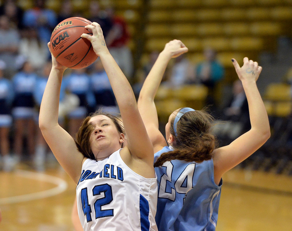 . Broomfield\'s Stacie Hull rebounds the ball   against Valor Christian\'s Madi Waldon during the final four 4A state game at Coors Event Center. (David R. Jennings/Broomfield Enterprise)
