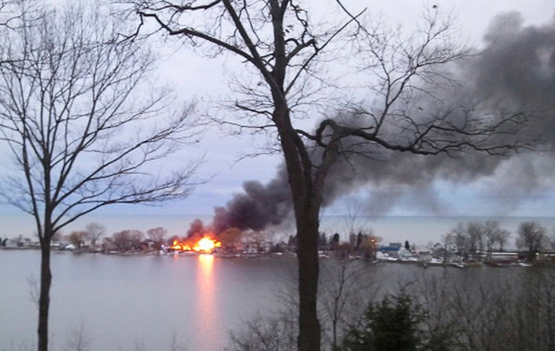 . A fire burns on Lake Road after a suspect shot four firefighters responding to the blaze in Webster, New York, December 24, 2012. At least two upstate New York firefighters were shot and killed and two wounded on Monday at the scene of an early morning house fire in a suburb of Rochester, according to local news reports. REUTERS/WHEC/Christine VanTimmeren/Handout