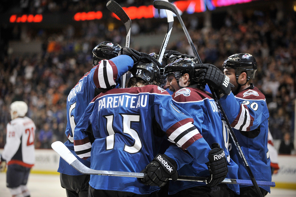 . Colorado Avalanche forward Pa Parenteau (15) celebrates his goal with teammates in the third period.  (Photo By Patrick Traylor/The Denver Post)