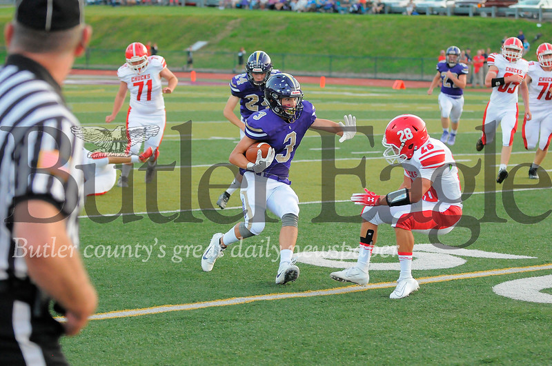 Karns City #3  Kaden Scherer runs the ball as Punxsutawney #28 Max London tries to block during a game at Deihl Stadium on Friday August 30, 2019 (Jason Swanson photo)