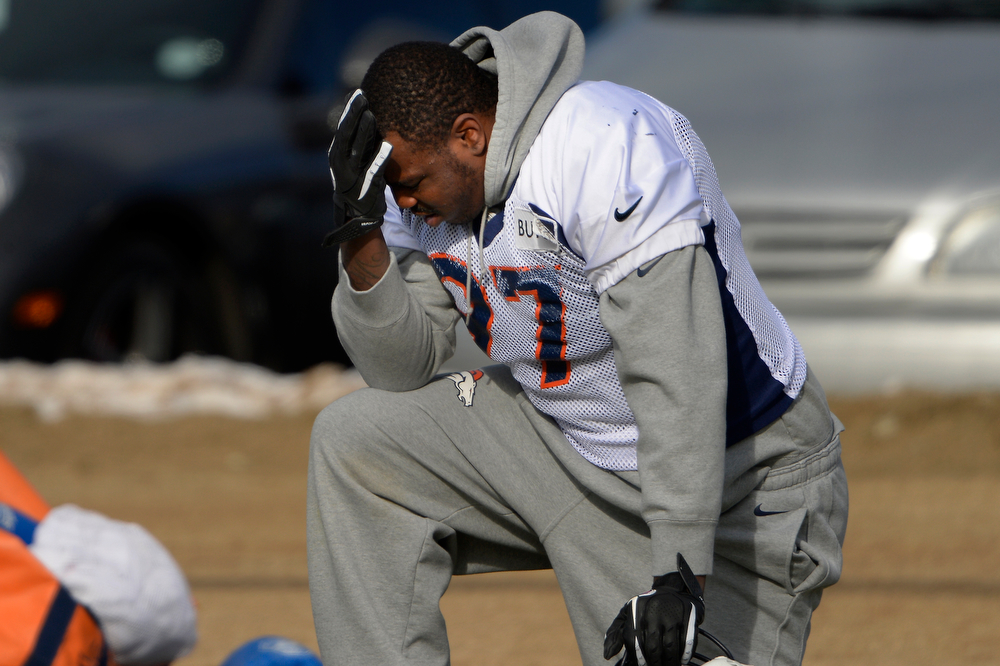 . Defensive end Malik Jackson #97 of the Denver Broncos takes a knee during practice at Dove Valley in Centennial January 10, 2014 Centennial, Colorado. (Photo by Joe Amon/The Denver Post)