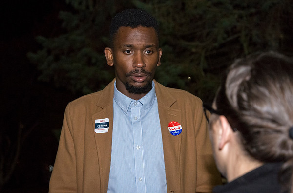 11/05/19 Wesley Bunnell | StaffrrDemocratic nominee for mayor Chris Porcher speaks to supporter Michelle Beharry outside of Slade Middle School on Tuesday evening.