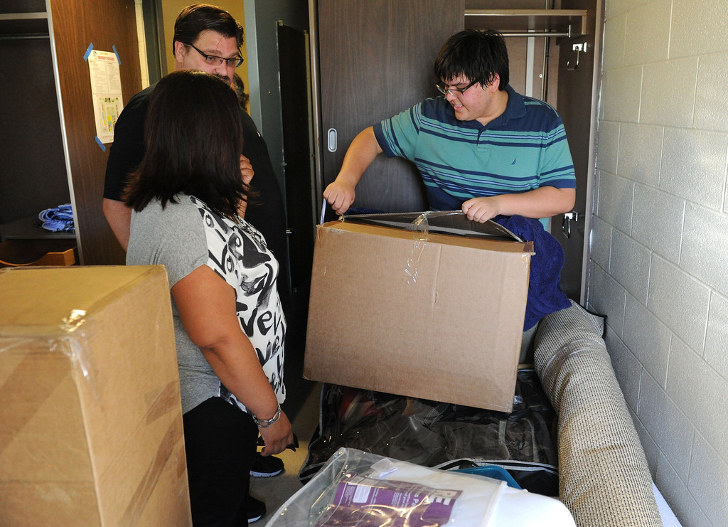 . (John Valenzuela/Staff Photographer) Freshman student Jacob Kern of Highlands, unpacks in his new dorm room with his parents Renee and Blaine by his side, Wednesday moring during move-in day at the University of Redlands, August 28, 2013.
