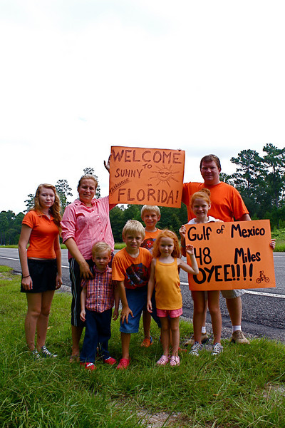 09 08-14 Family comes out to cheer the bikers on with posters made by the kids. ec