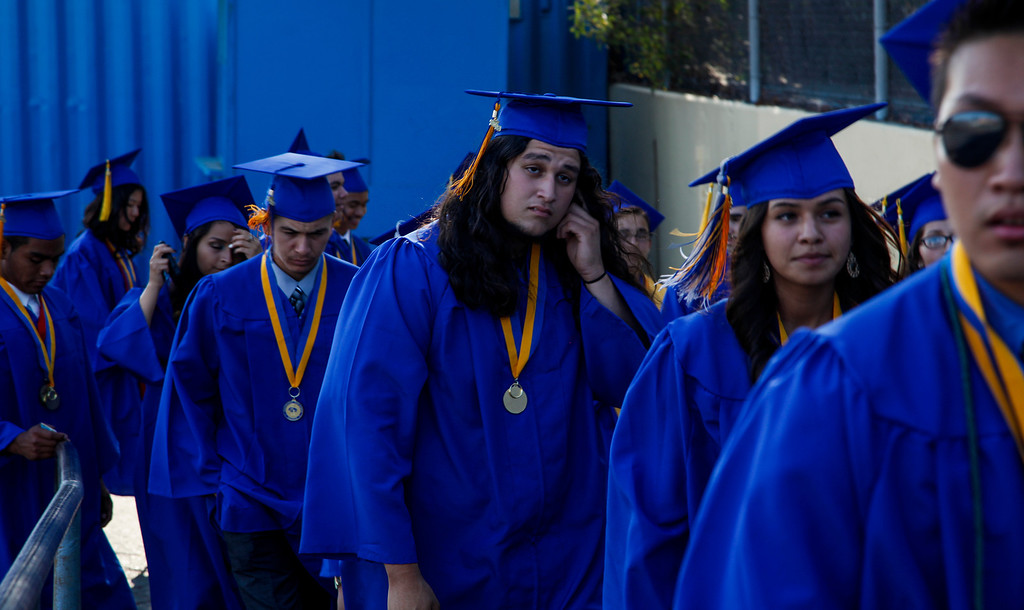 . Eliazar Estrella and classmates make their way to waiting, teachers, family, and friends, as the processional makes its way to the football field, at John H Francis Polytechnic High School, Sun Valley, Calif., June 7, 2013. Photo: Lynn Levitt.