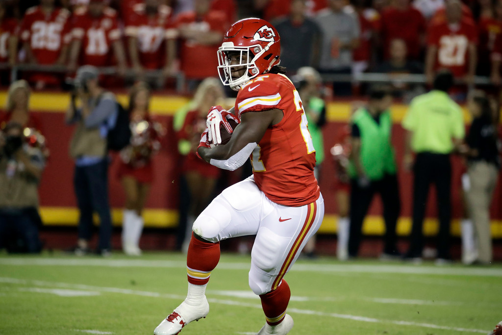 . Kansas City Chiefs running back Kareem Hunt (27) carries the ball during the first half of an NFL football game against the Washington Redskins in Kansas City, Mo., Monday, Oct. 2, 2017. (AP Photo/Charlie Riedel)