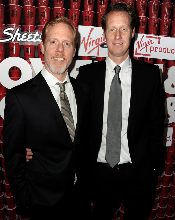 """. Writer/directors Scott Moore (L) and Jon Lucas arrive at the premiere of Relativity Media\'s \""""21 And Over\"""" at the Village Theatre on February 21, 2013 in Los Angeles, California.  (Photo by Kevin Winter/Getty Images)"""