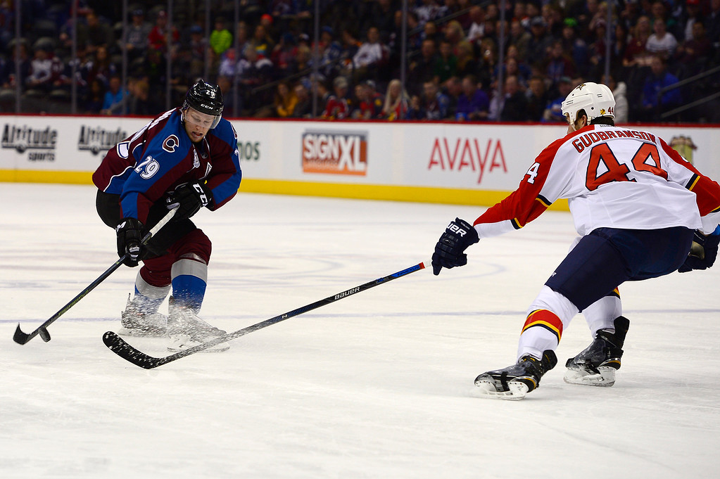 . DENVER, CO - MARCH 3: Colorado Avalanche center Nathan MacKinnon (29) tries to regain control on the puck while trying to move around Florida Panthers defenseman Erik Gudbranson (44) during the first period at the Pepsi Center on March 3, 2016 in Denver, Colorado. (Photo by Brent Lewis/The Denver Post)