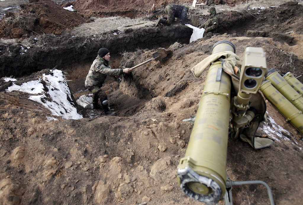 . Servicemen prepare their new position near Artemivsk, in the Donetsk region on February 19, 2015 after they left Debaltseve on February 19, 2015. More than 90 Ukrainian troops were captured and 82 were still missing after pro-Russian rebels seized the key town of Debaltseve, Ukraine\'s army said Thursday. Some 2,500 exhausted government troops retreated from Debaltseve -- a key railway hub linking the main separatist-held cities of Donetsk and Lugansk -- after rebels ignored a supposed truce to seize control of the town. AFP PHOTO/ ANATOLII STEPANOVANATOLII STEPANOV/AFP/Getty Images
