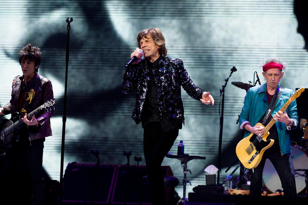 . Ronnie Wood, from left, Mick Jagger and Keith Richards of The Rolling Stones perform in concert on Saturday, Dec. 8, 2012 in New York. (Photo by Charles Sykes/Invision/AP)