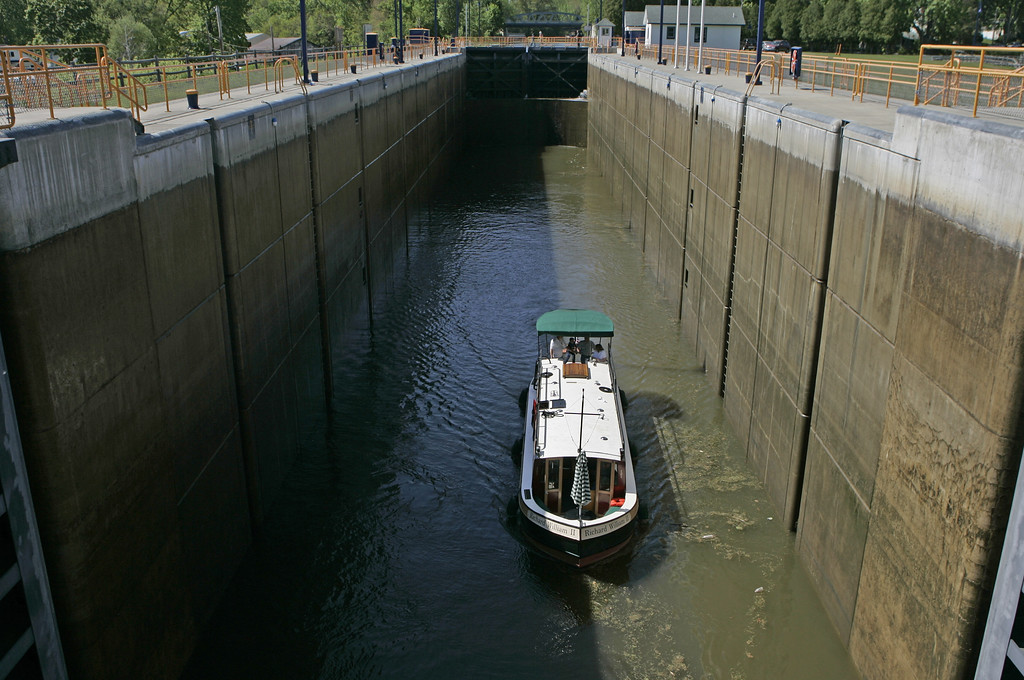 . In this May 13, 2008 file photo, a canal boat goes through Lock 2 of the Erie Canal in Waterford, N.Y. Ground was broken for the Erie Canal 200 years ago, and when the 363-mile canal fully opened in 1825, it was the greatest engineering feat of the era and one that would change history. (AP Photo/Mike Groll, File)