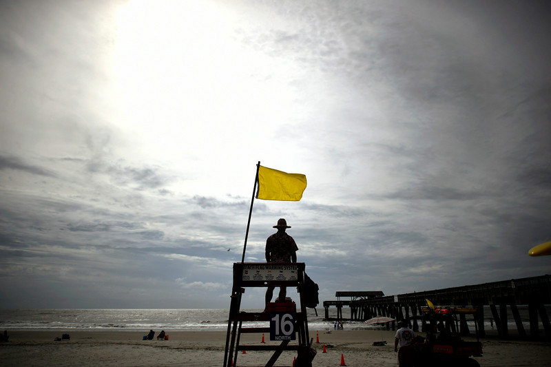. Tybee Island Ocean Rescue Senior Lifeguard Jerry Hazellief watches for rip currents from Hurricane Arthur from his lifeguard tower on the beach on Tybee Island, Ga., Thursday, July 3, 2014. The storm has bypassed the Georgia coast as predicted, but forecasters are warning beach goers to beware of dangerous rip currents in its wake. (AP Photo/Stephen B. Morton)