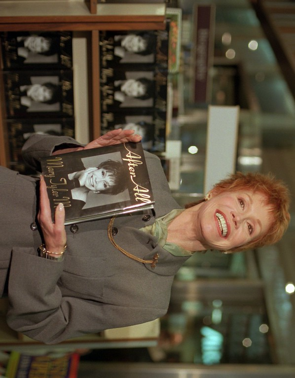 ". Actress Mary Tyler Moore displays her new book, an autobiography entitled  ""After All,\"" during a book signing at B. Dalton Booksellers in New York Tuesday, Oct. 31, 1995. (AP Photo/Mark Lennihan)"