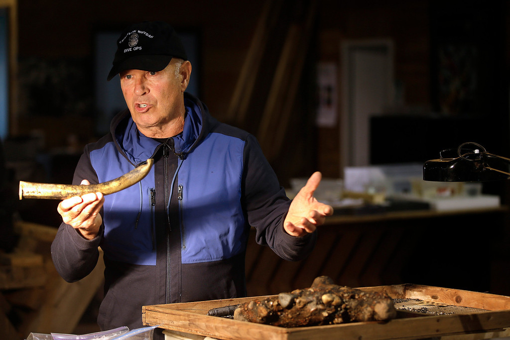""". Underseas explorer Barry Clifford holds the barrel of a partially crushed blunderbuss he salvaged from the wreck of pirate ship \""""Whydah\"""" during a video interview in Brewster, Mass., Tuesday, Sept. 17, 2013.  (AP Photo/Stephan Savoia)"""
