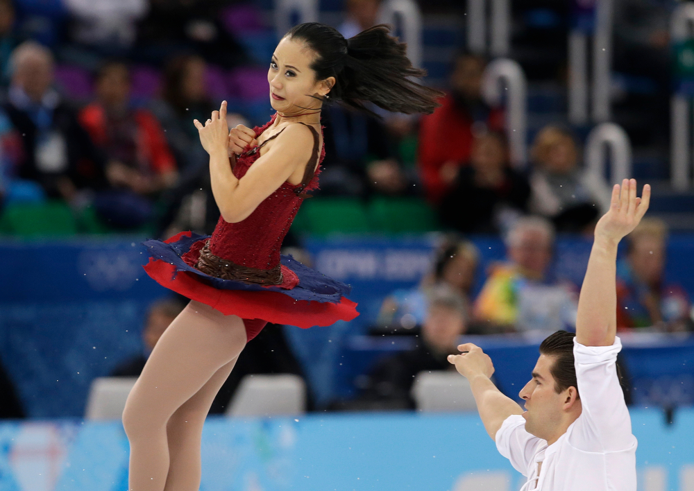 . Felicia Zhang and Nathan Bartholomay of the United States compete in the pairs free skate figure skating competition at the Iceberg Skating Palace during the 2014 Winter Olympics, Wednesday, Feb. 12, 2014, in Sochi, Russia. (AP Photo/Darron Cummings)