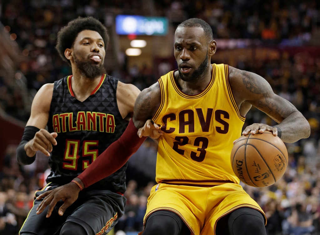 . Cleveland Cavaliers\' LeBron James (23) drives around Atlanta Hawks\' DeAndre Bembry (95) in the second half of an NBA basketball game, Friday, April 7, 2017, in Cleveland. (AP Photo/Tony Dejak)
