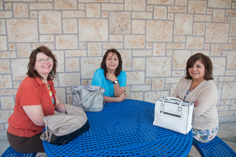 Katharine Fischer (left), Angie Dick, and Bonnie Salas take a break in Lee Plaza.