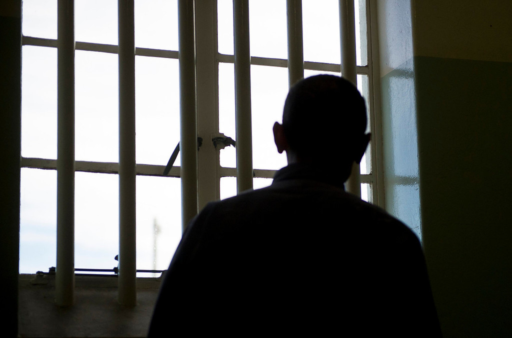 . US President Barack Obama looks out the window from the cell where Nelson Mandela was once jailed on Robben Island, on June 30, 2013. Paying homage to the 94-year-old former South-African president and anti-apartheid activist who is critically ill in the hospital, Obama stared into the stark cell where Mandela spent two thirds of his 27 years in jail.  JIM WATSON/AFP/Getty Images