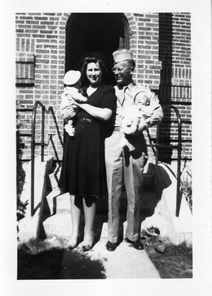 "Printed on back of photo by my Dad: ""9/26/43 - Dick with Mom + Bill with Dad. .. In front of church chapel after being Baptized - St Anthony Catholic Church. .. The Lord wiped out their sins but Pa will remember them - My! The diapers he washed."""