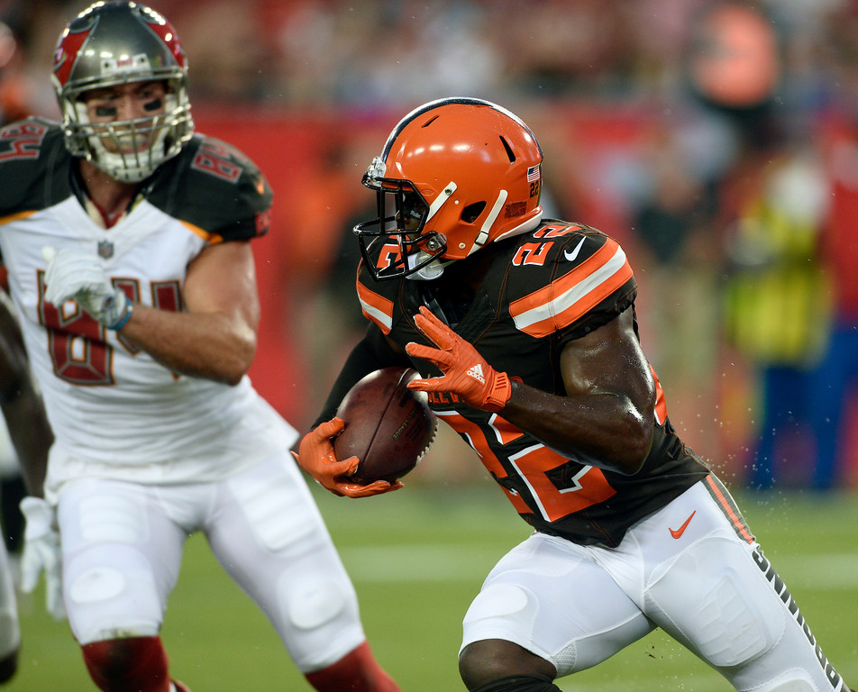 . Cleveland Browns linebacker Jabrill Peppers (22) runs past Tampa Bay Buccaneers tight end Cameron Brate (84) after intercepting a pass by Jameis Winston during the first quarter of an NFL preseason football game Saturday, Aug. 26, 2017, in Tampa, Fla. (AP Photo/Jason Behnken)