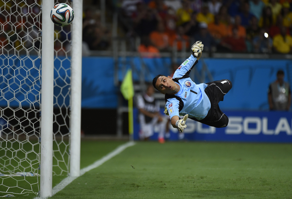 . Costa Rica\'s goalkeeper Keylor Navas dives for the ball during the quarter-final football match between the Netherlands and Costa Rica at the Fonte Nova Arena in Salvador during the 2014 FIFA World Cup on July 5, 2014.  (ODD ANDERSEN/AFP/Getty Images)