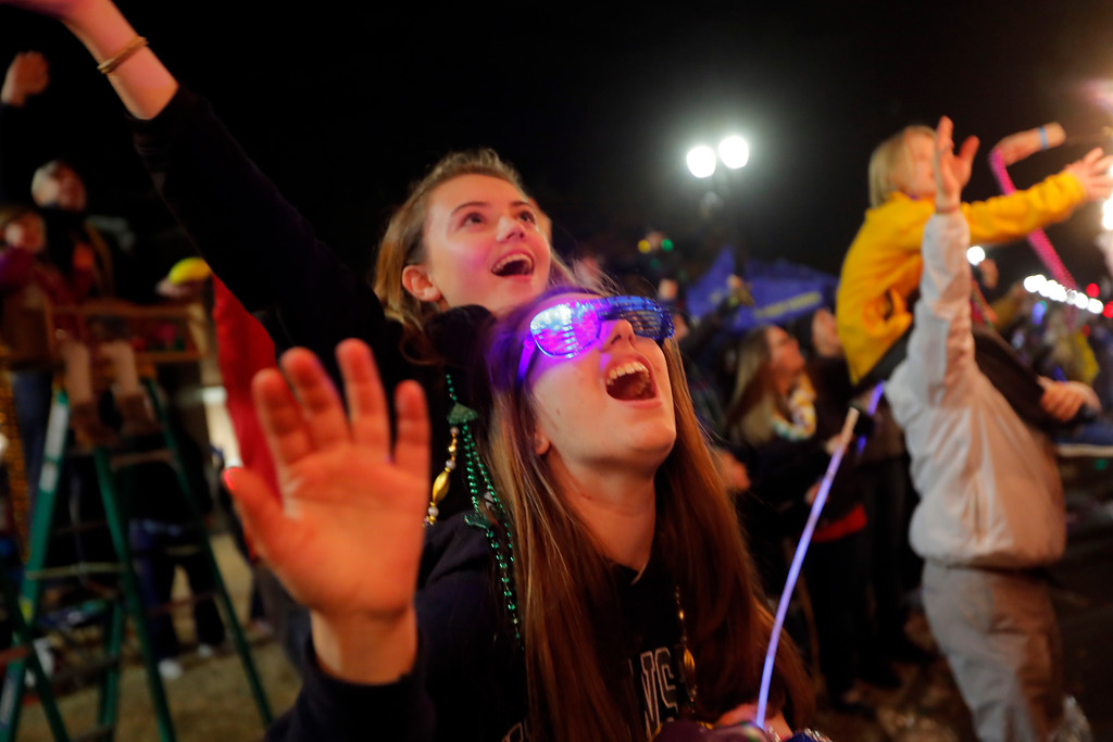 . Revelers scream for trinkets at the Krewe of Cleopatra Mardi Gras parade in New Orleans, Friday, Feb. 2, 2018. Mardi Gras season is kicking into high gear with a slew of major parades throughout New Orleans. Although Carnival season officially began Jan. 6, the festivities really kick into high gear the two weekends ahead of Fat Tuesday. This year Fat Tuesday is Feb. 13. (AP Photo/Gerald Herbert)
