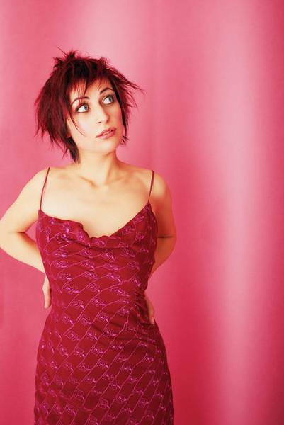 © Robert Karpa Portrait of Woman in Pink Room