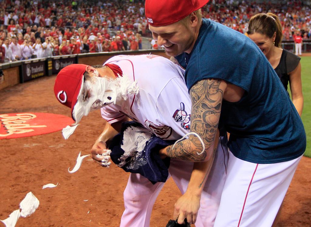 . Cincinnati Reds starting pitcher Homer Bailey, left, gets a face full of shaving cream from Mat Latos after Bailey threw a no-hitter against the San Francisco Giants in a baseball game, Tuesday, July 2, 2013, in Cincinnati. Cincinnati won 3-0. (AP Photo/Al Behrman)