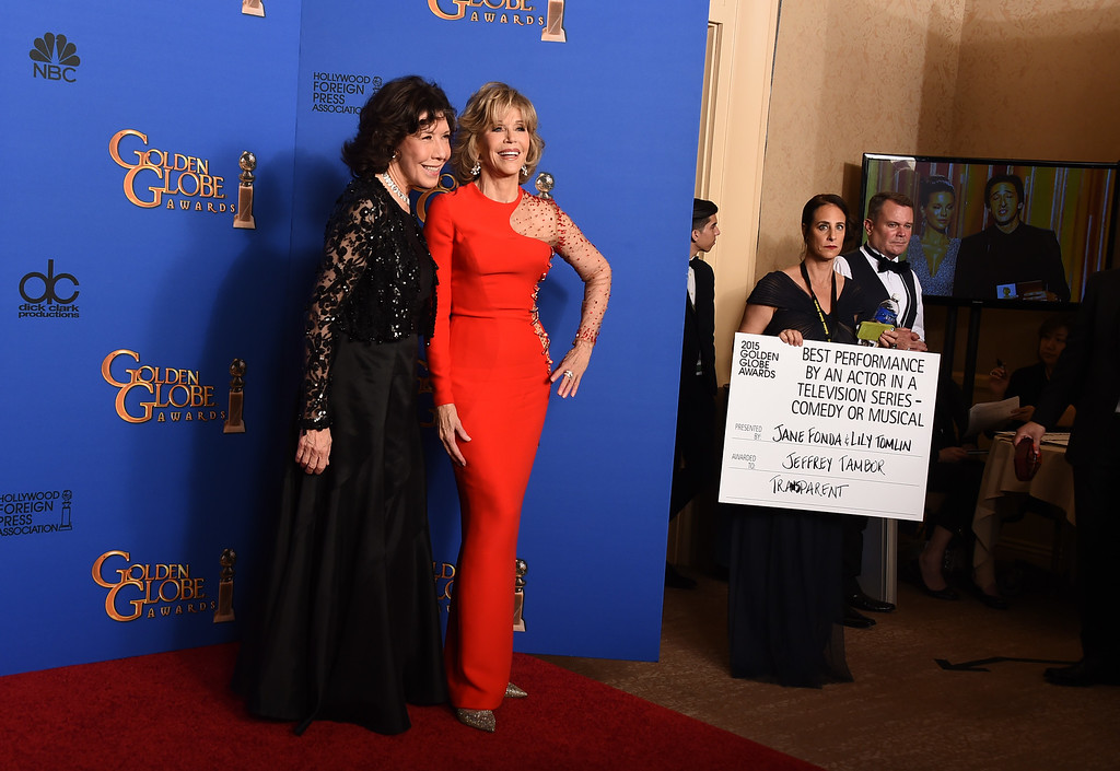 . Lily Tomlin, left and Jane Fonda pose in the press room at the 72nd annual Golden Globe Awards at the Beverly Hilton Hotel on Sunday, Jan. 11, 2015, in Beverly Hills, Calif. (Photo by Jordan Strauss/Invision/AP)