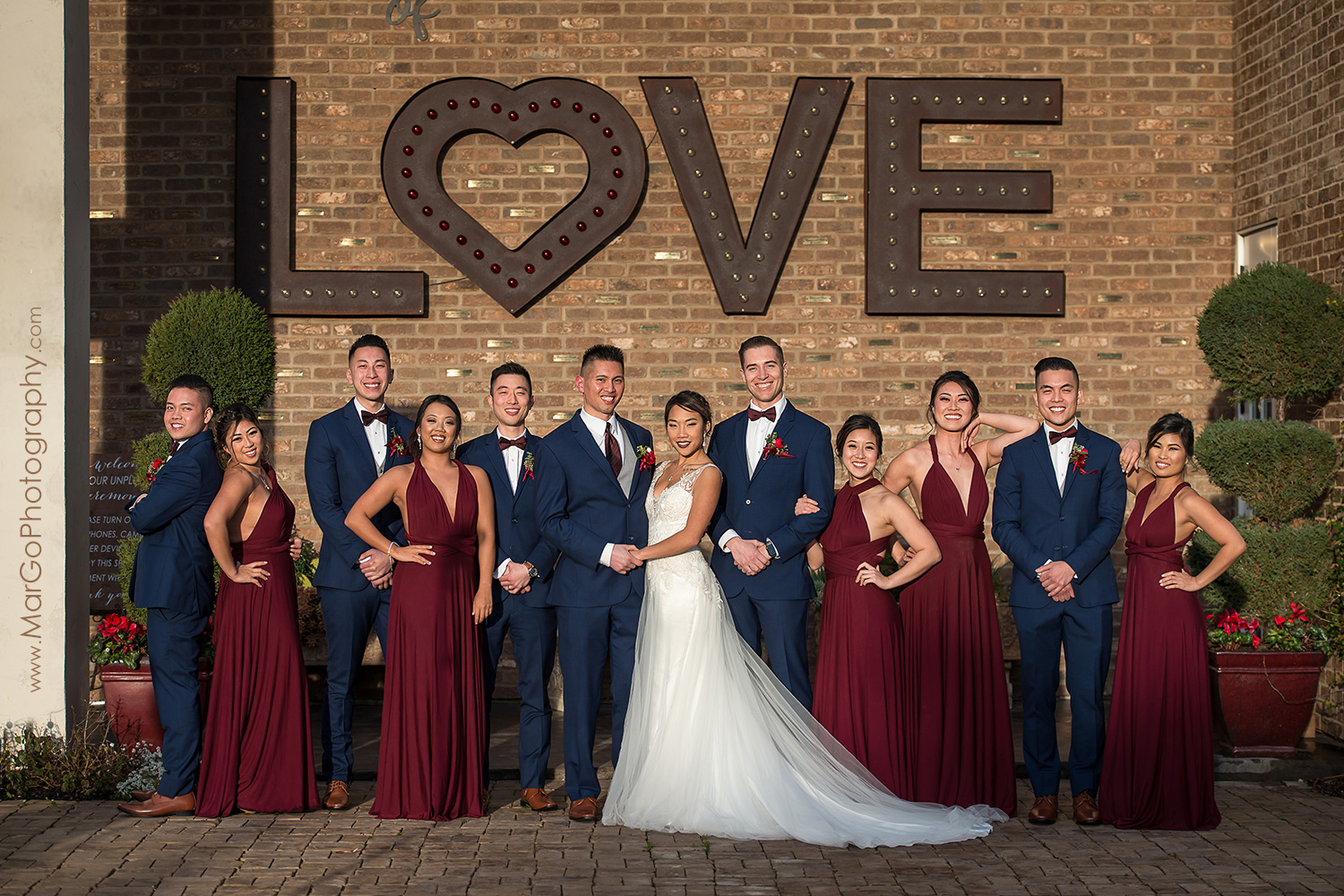bridal party under the LOVE sign at Sunol's Casa Bella