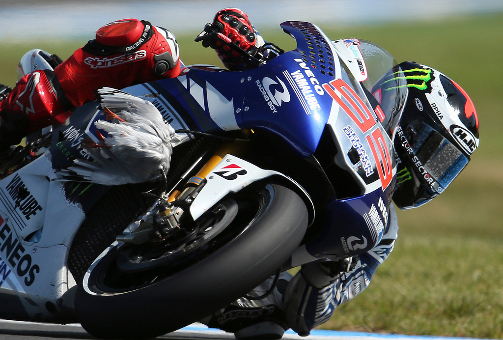 . Yamaha MotoGP rider Jorge Lorenzo of Spain controls his bike on turn 11 after a bird hit the front of his fairing during the qualifying session of the MotoGP Australian motorcycle Grand Prix in Phillip Island, Australia, Saturday, Oct. 19, 2013. Lorenzo qualified fastest to take pole position for the Australian MotoGP.(AP Photo/Rob Griffith, File)