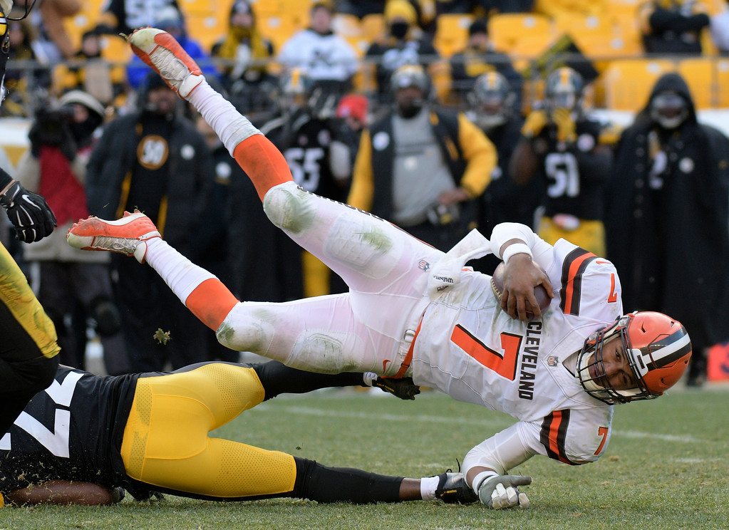 . Cleveland Browns quarterback DeShone Kizer (7) is upended by Pittsburgh Steelers free safety William Gay (22) at the end of a run during the second half of an NFL football game in Pittsburgh, Sunday, Dec. 31, 2017. (AP Photo/Don Wright)