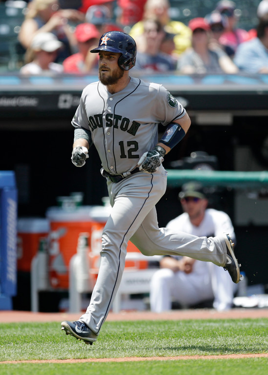 . Houston Astros\' Max Stassi runs the bases after hitting a solo home run off Cleveland Indians starting pitcher Trevor Bauer in the second inning of a baseball game, Sunday, May 27, 2018, in Cleveland. (AP Photo/Tony Dejak)