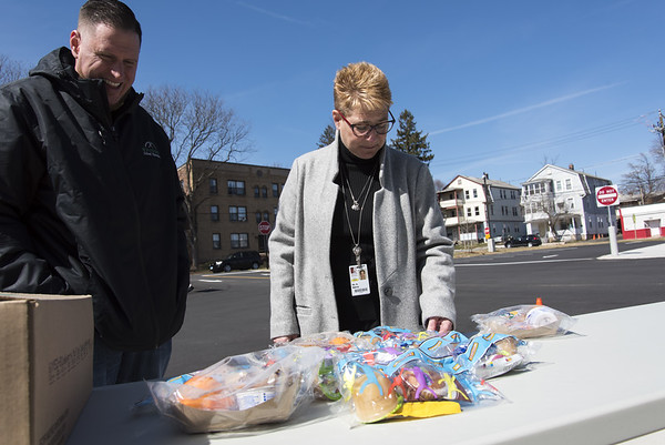 File Wesley Bunnell | Staff School lunches are being provided at no charge to New Britain residents in the wake of forced school closings due to the Coronavirus. Standing outside of Smalley School on Monday March 16, 2020 are eJeff Taddeo, Resident District manger for Whitsons School Nutrition, L, as he looks over the specially packaged cold lunches available along with CSDNB Superintendent of Schools Nancy Sarra.